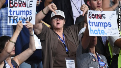 A Bernie Sanders supporter gestures during Day 1 of the Democratic National Convention at the Wells Fargo Center in Philadelphia, Pennsylvania, July 25, 2016. / AFP / Robyn BECK        (Photo credit should read ROBYN BECK/AFP/Getty Images)