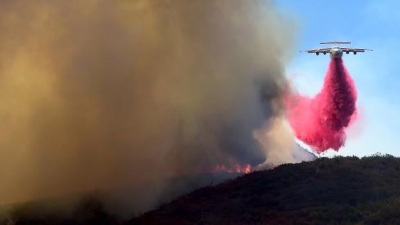 A plane drops fire retardant in the mountains near Santa Clarita.