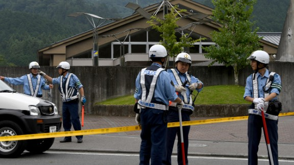 Police officers cordon off the entrance to the Tsukui Yamayuri-en center. The attacker has been identified as 26-year-old Satoshi Uematsu, a man who had worked at the facility until February. After breaking in through a window and carrying out the attack, Uematsu turned himself into local police, officials said.