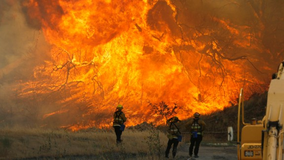 A hillside erupts in flame in Placerita Canyon in Santa Clarita, California on Monday, July 25. Fire officials said the so-called Sand Fire was growing at the rate of 10,000 acres per day and could potentially spread in any of three directions depending on changing winds. The wildfire has already scorched more than 33,000 acres and destroyed at least 18 homes.