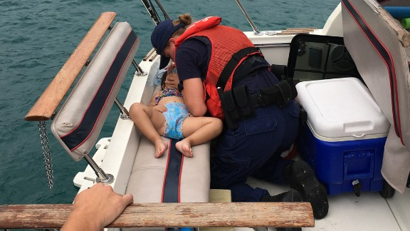 Coast Guard Seaman Amanda Wolf performs CPR on a 2-year-old girl who fell off a boat and into Lake Michigan on Thursday, July 21. Wolf successfully resuscitated the child.