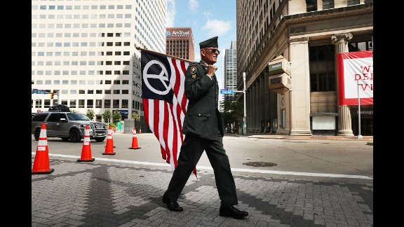 Lou Pumphrey, who is with the nonprofit Veterans for Peace, walks through downtown Cleveland on Sunday, July 17, ahead of the Republican National Convention.