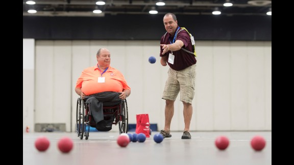 U.S. Army veterans Tom Brown, left, and Tom Southall learn to play bocce Sunday, July 10, during the National Veterans Golden Age Games in Det