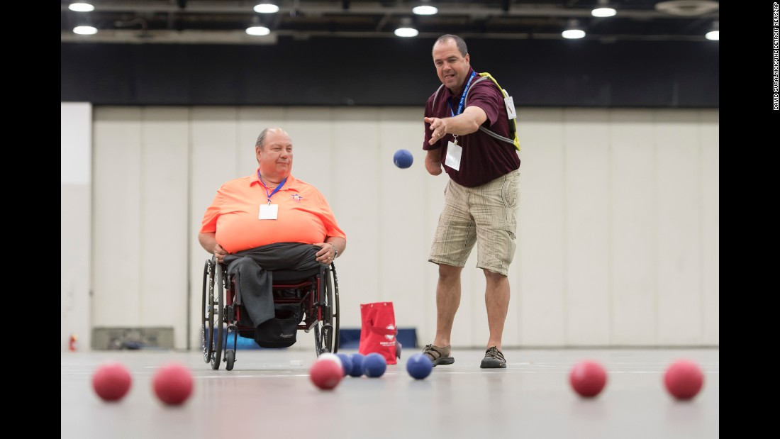 U.S. Army veterans Tom Brown, left, and Tom Southall learn to play bocce Sunday, July 10, during the National Veterans Golden Age Games in Detroit.