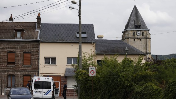 "Police officers stand on guard behind the church of Saint-Etienne-du-Rouvray on July 26, 2016, following an attack by two knife-wielding men. The Islamic State group said on July 26 that the two assailants who stormed a church in France and killed an elderly priest were its ""soldiers,"". They stormed the church during morning mass, taking the five people inside hostage and slitting the throat of its priest Jacques Hemel, who was in his eighties. The attackers were killed by police after they emerged from the church when it was surrounded by France's anti-gang brigade, the BRI, which specialises in kidnappings.  / AFP PHOTO / CHARLY TRIBALLEAUCHARLY TRIBALLEAU/AFP/Getty Images"