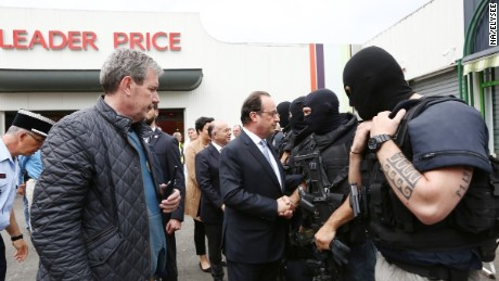 French President Francois Hollande meets police who responded to the attack in Saint-Etienne-du-Rouvray.