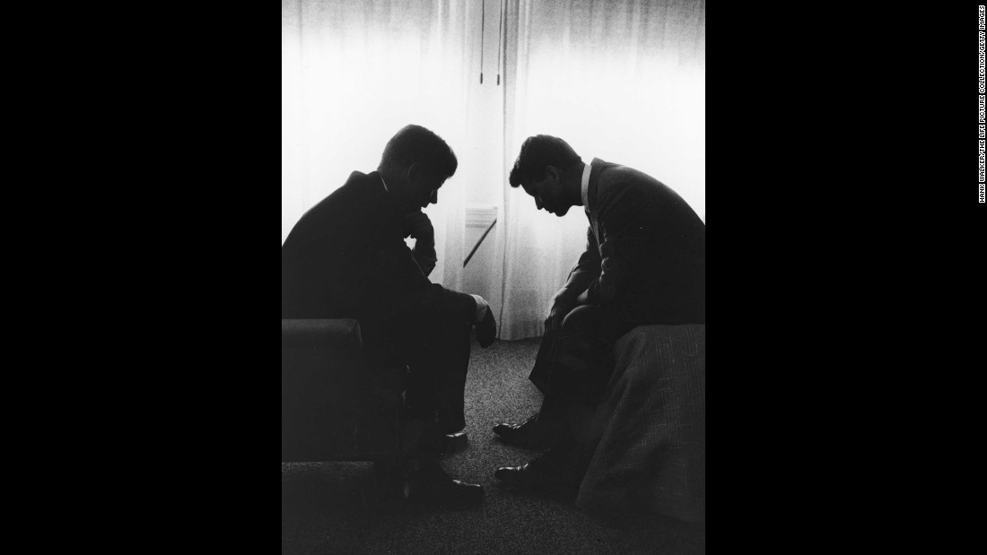 Presidential candidate John F. Kennedy, left, confers with his younger brother and campaign manager, Robert, in a Los Angeles hotel suite in July 1960. It was the week of the Democratic National Convention.
