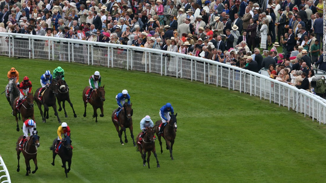 "Glorious Goodwood got under way Tuesday as hordes of spectators headed to the Sussex Downs in southern England to celebrate the ""last hurrah"" of the summer social season."