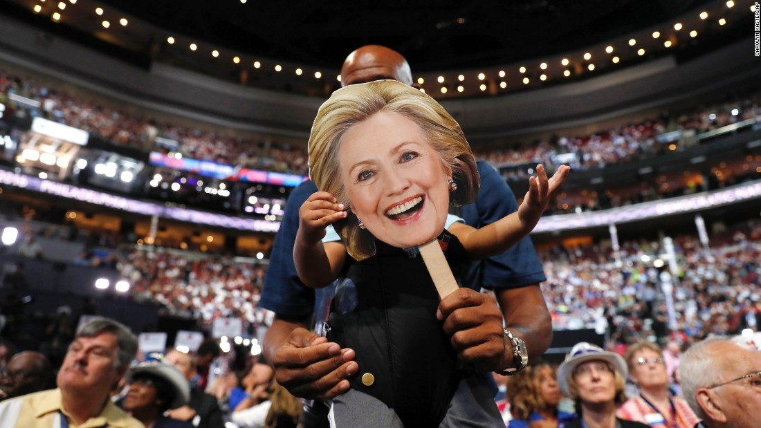 Florida delegate Bernard Jennings holds a cardboard cutout of Hillary Clinton over the face of his young son Ethan on Tuesday.