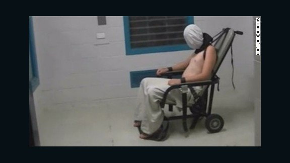 """The """"Four Corners"""" program reported that this image shows Dylan Voller, then 17, in a white hood, shackled at the neck with his arms strapped to a chair at a detention center in Alice Springs, Australia."""