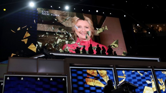 Clinton appears live on a video screen Tuesday night. Just a few hours earlier, she officially became the party