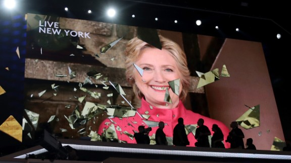 PHILADELPHIA, PA - JULY 26:  A screen displays Democratic presidential candidate Hillary Clinton delivering remarks during the evening session on the second day of the Democratic National Convention at the Wells Fargo Center, July 26, 2016 in Philadelphia, Pennsylvania. Democratic presidential candidate Hillary Clinton received the number of votes needed to secure the party