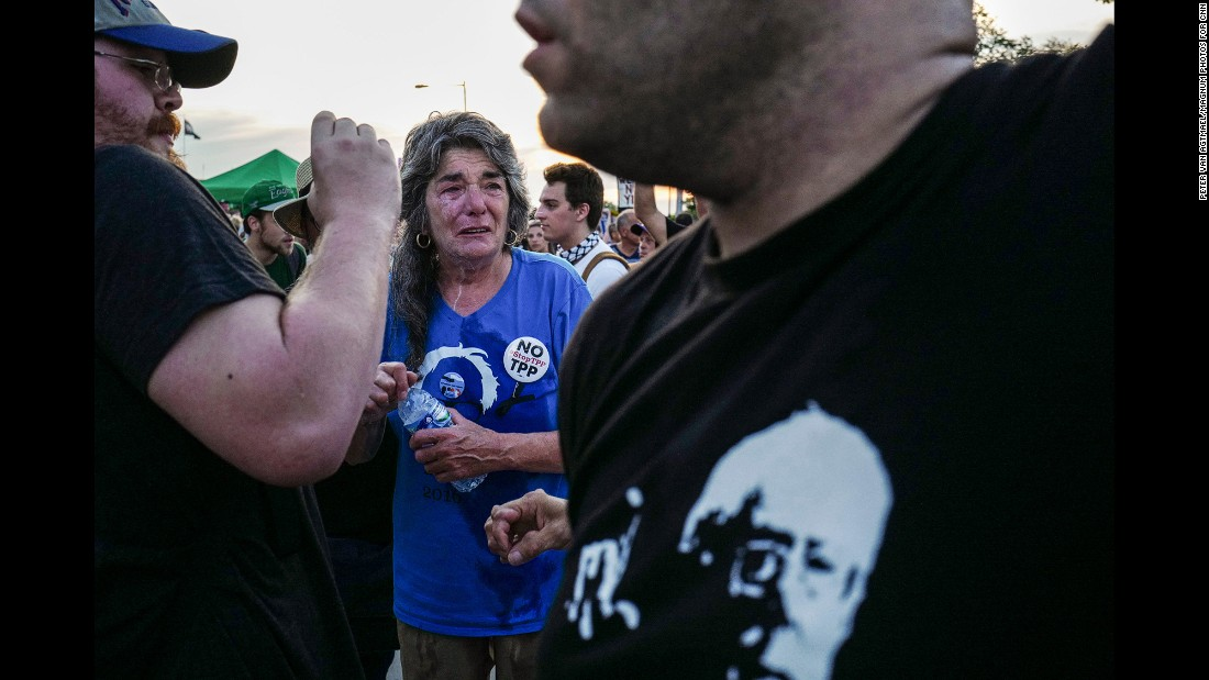 "A woman reacts after allegedly being pepper-sprayed as a group of protesters tried to push through the police lines and enter the convention on Tuesday. Van Agtmael also covered the <a href=""http://www.cnn.com/2016/07/20/politics/gallery/outside-rnc-van-agtmael/index.html"" target=""_blank"">Republican National Convention</a> last week. ""There are a lot more protesters this week, and the protests are a lot more spirited,"" he noted."