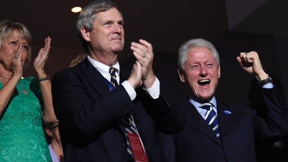 Former U.S. President Bill Clinton, right, cheers during the speech of former New York City Mayor Michael Bloomberg.