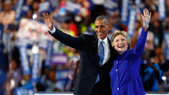 US President Barack Obama and Democratic presidential candidate Hillary Clinton wave to the crowd on the third day of the Democratic National Convention at the Wells Fargo Center, July 27, 2016 in Philadelphia, Pennsylvania. Democratic presidential candidate Hillary Clinton received the number of votes needed to secure the party