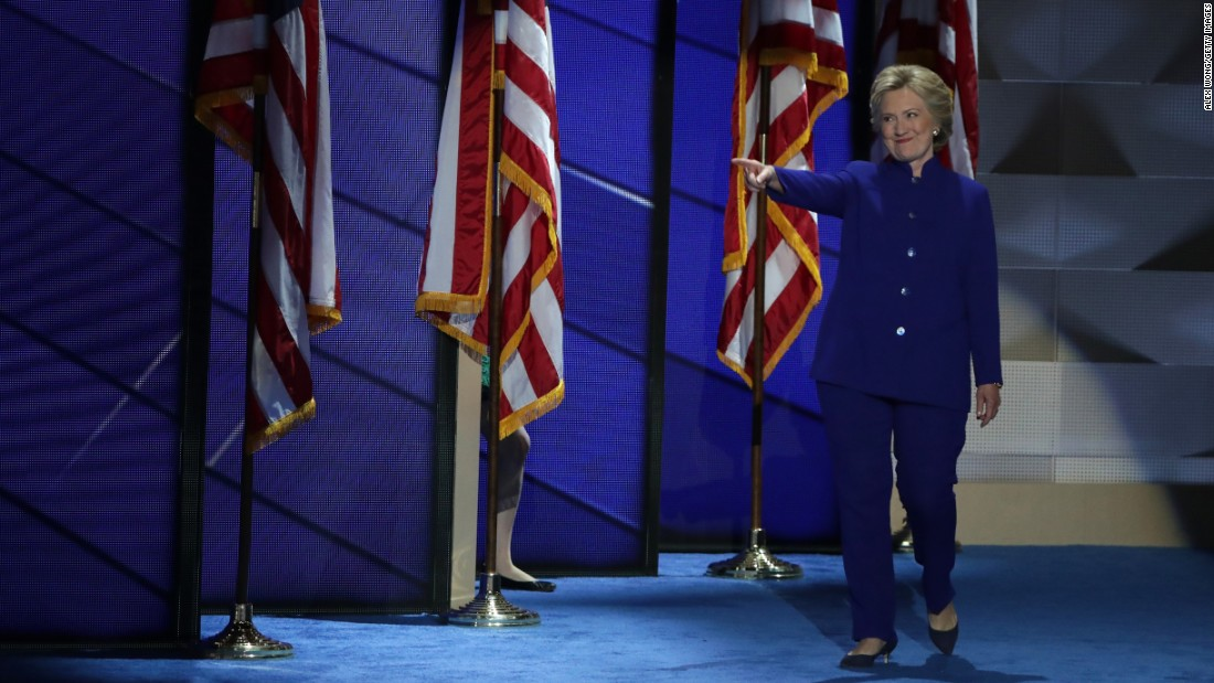 Clinton points to Obama as she walks on stage after his speech.