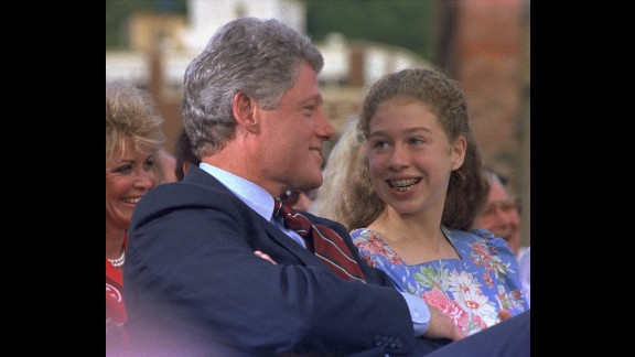 Chelsea, 12, speaks with her dad before a campaign rally in Hot Springs, Arkansas, in September 1992. He was running for President at the time.