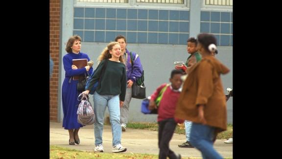 Chelsea is seen outside her school in Little Rock, Arkansas, in November 1992.
