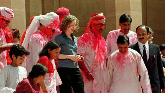 Chelsea walks down the steps of a palace in Jodhpur, India, in March 2000. She visited Jodhpur to watch Holi, the Indian festival of colors, during her father