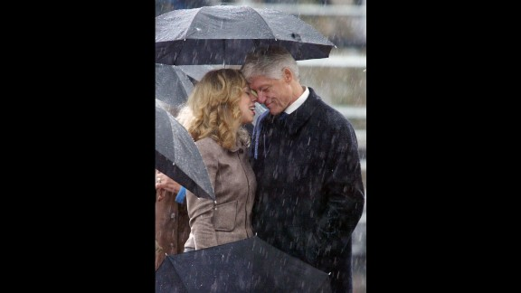 Father and daughter share an emotional moment in November 2004 during opening ceremonies for the William J. Clinton Presidential Center in Little Rock.