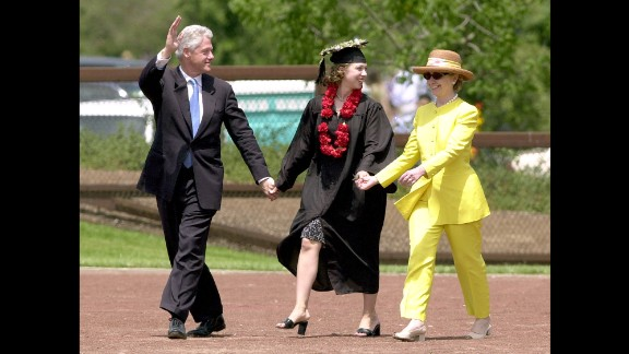 Bill Clinton waves after his daughter