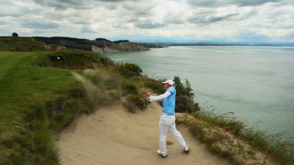 Doak's other top-100 course is Cape Kidnappers in New Zealand, set on the rugged Hawke's Bay coast. Here American golfer Anthony Kim plays out of a bunker during a 2009 tournament.