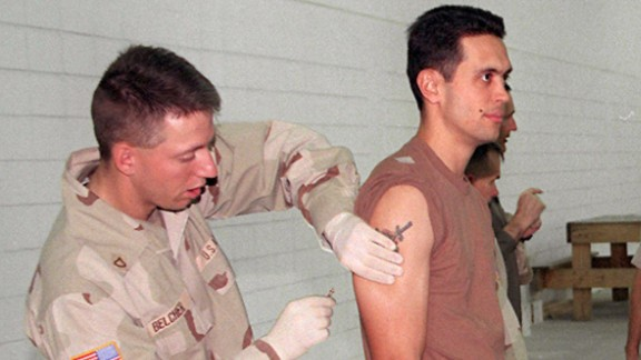 U.S. soldiers in Kuwait in 1998 are vaccinated  against anthrax, one of the germ warfare agents suspected to be in Iraq's arsenal of banned weapons of mass destruction.