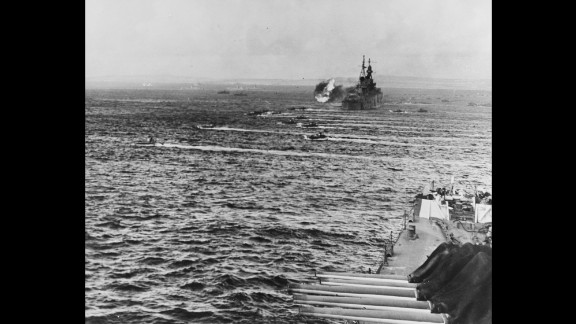The Indianapolis, in the background, played a major role in operations off Saipan, knocking out Japanese fortifications and weapons. Fifth Fleet commander Adm. Raymond A. Spruance often used the cruiser as his flagship.