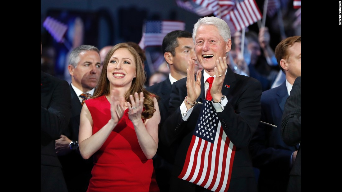 Clinton's husband, former U.S. President Bill Clinton, applauds along with their daughter, Chelsea.