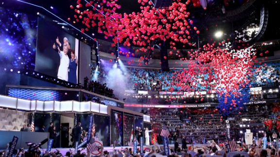 Balloons fall from the ceiling of the Wells Fargo Center after Clinton