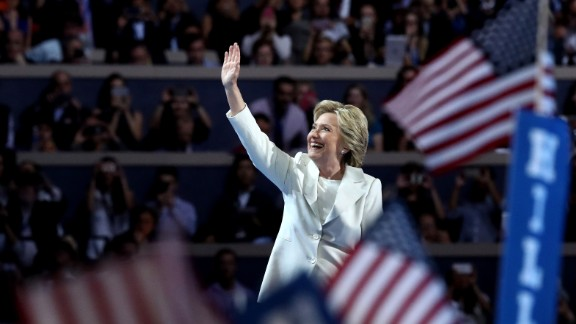 Democratic presidential candidate Hillary Clinton acknowledges the crowd as she arrives on stage during the fourth day of the Democratic National Convention at the Wells Fargo Center, July 28, 2016 in Philadelphia, Pennsylvania. Democratic presidential candidate Hillary Clinton received the number of votes needed to secure the party