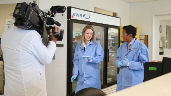 Holmes gives Dr. Gupta a rare tour of a Theranos lab based in Palo Alto, California.