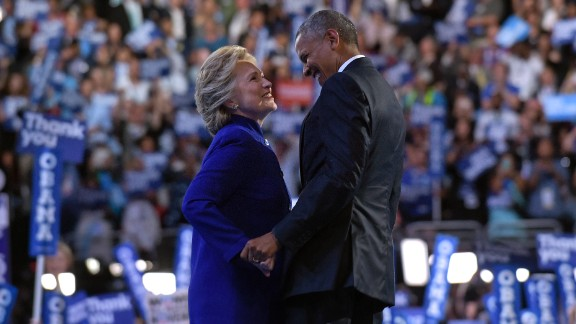 President Barack Obama, right, talks with Democratic presidential candidate Hillary Clinton, left, following Obama