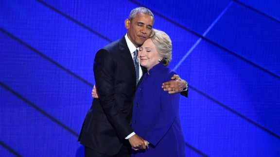 U.S. President Barack Obama hugs Hillary Clinton after speaking at the Democratic National Convention on Wednesday, July 27. Obama told the crowd at Philadelphia