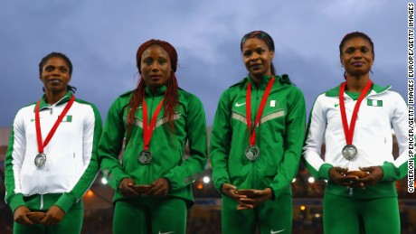 GLASGOW, SCOTLAND - AUGUST 02:  Silver medalists Patience George, Regina George, Ada Benjamin and Folashade Abugan of Nigeria on the podium during the medal ceremony for the Women's 4x400 metres relay  at Hampden Park during day ten of the Glasgow 2014 Commonwealth Games on August 2, 2014 in Glasgow, United Kingdom.  (Photo by Cameron Spencer/Getty Images)