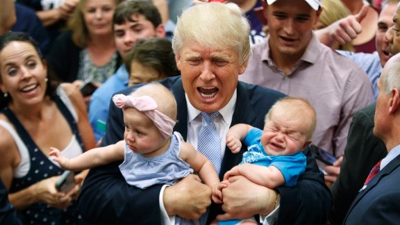 Republican presidential nominee Donald Trump holds Kellen Campbell of Denver, right, and Evelyn Keane, of Castle Rock, Colorado, during a campaign rally on Friday, July 29 in Colorado Springs.