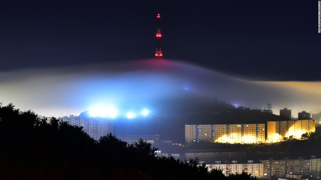 Mist covers a radio tower in Vladivostok, Russia, on Thursday July 7.