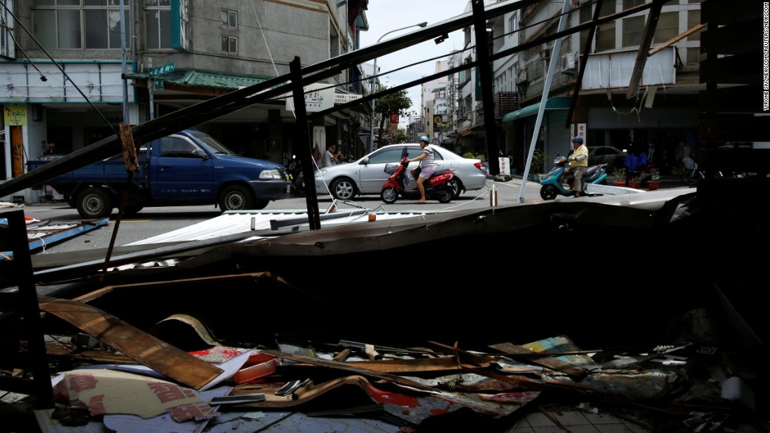 "Damaged buildings and debris are seen on Saturday, July 9, after <a href=""http://www.cnn.com/2016/07/06/world/super-typhoon-nepartak-taiwan/"" target=""_blank"">Typhoon Nepartak</a> passed through Taitung, Taiwan."