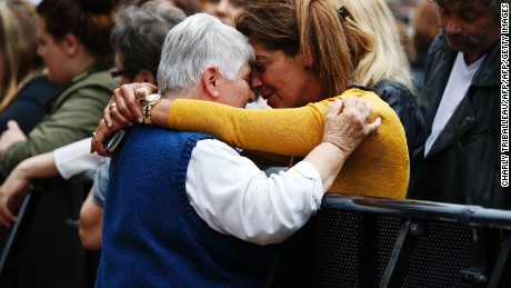 At a memorial ceremony for Rev. Jacques Hamel, woman hugs Sister Daniele Delafosse, a nun who taken hostage during the attack.