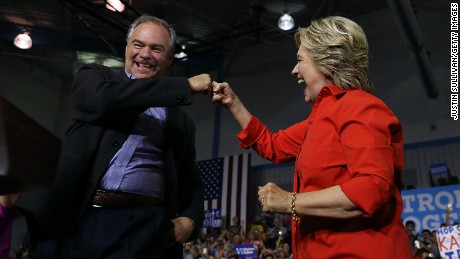 YOUNGSTOWN, OH - JULY 30:  Democratic presidential nominee former Secretary of State Hillary Clinton and democratic vice presidential nominee U.S. Sen Tim Kaine (D-VA) fist bump during a campaign rally at East High School on July 30, 2016 in Youngstown, Pennsylvania. Hillary Clinton and Tim Kaine are continuing their three-day bus tour through Pennsylvania and Ohio.  (Photo by Justin Sullivan/Getty Images)