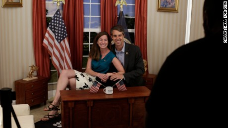 People have their photo taken in a mock Oval Office at the DNC (Callie Shell for CNN)