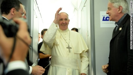 "Pope Francis (C) waves next to newly-retired Father Federici Lombardi (R) during a press conference on a plane after the Pope's visit to Krakow for the World Youth Days, on July 31, 2016. Pope Francis celebrated mass on July 31, 2016 with over 1.5 million pilgrims in a vast sun-drenched field in Poland, wrapping up an emotionally charged trip with some choice technological metaphors. In a nod to today's internet-dominated world, Francis urged the faithful, who had travelled to Poland from all over the world, to ""download the best link of all, that of a heart which sees and transmits goodness without growing weary"". / AFP / POOL / Filippo MONTEFORTE        (Photo credit should read FILIPPO MONTEFORTE/AFP/Getty Images)"