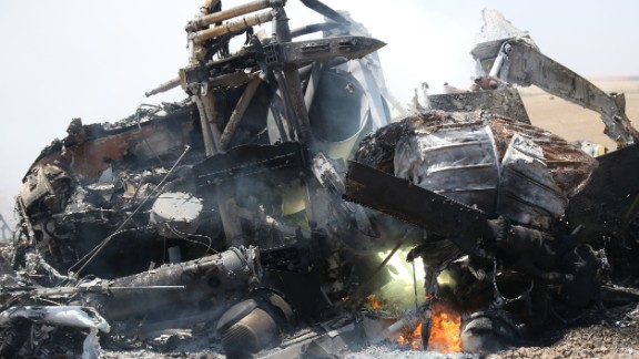 Wreckage of the Russian helicopter is seen Monday after it went down in Idlib province.