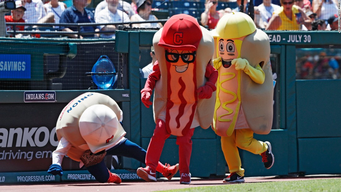 Ketchup trips Onion as hot dogs race at a Cleveland Indians baseball game on Wednesday, July 27.