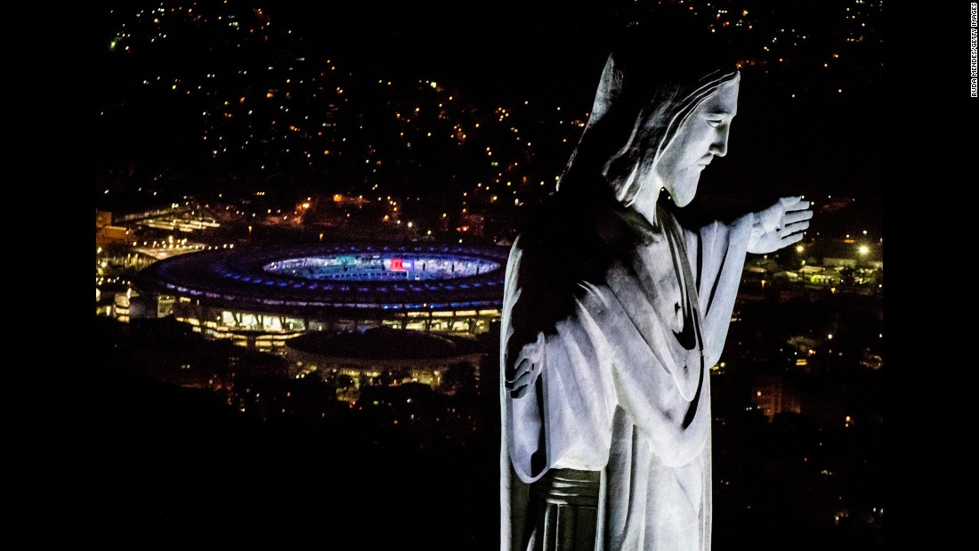 The Maracana Stadium is seen behind the Christ the Redeemer statue in Rio de Janeiro on Sunday, July 31. The Summer Olympics begin in Rio on August 5.