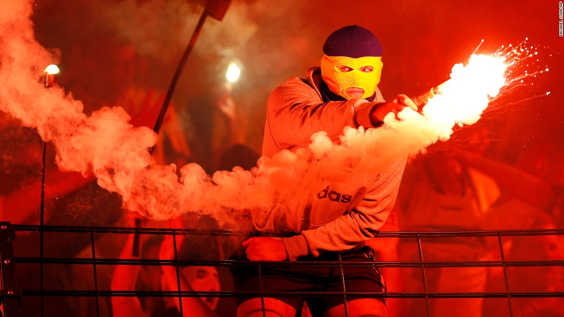 A supporter of the Danish soccer club Brondby lights fireworks during a Europa League match in Berlin on Thursday, July 28.