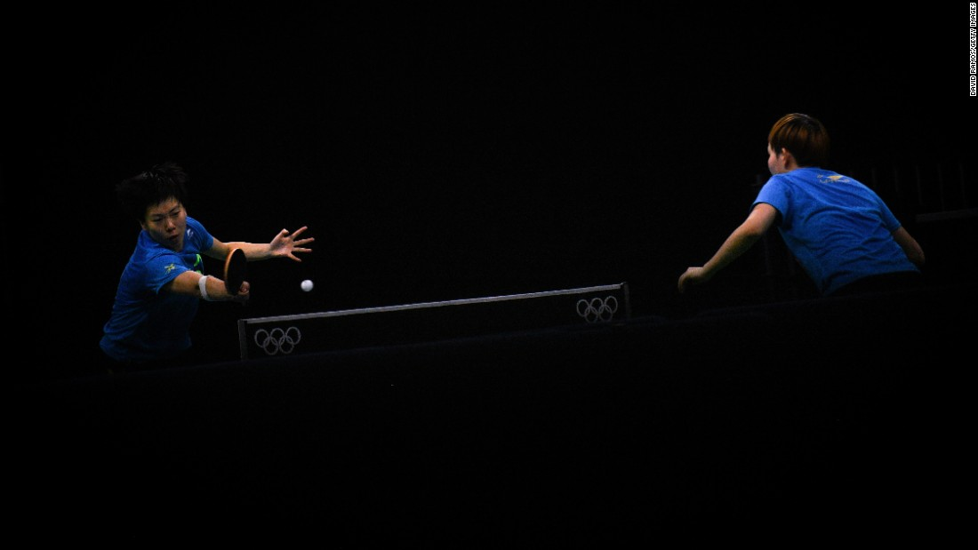 Chinese Olympians Li Xiaoxia, left, and Ding Ning practice in Rio de Janeiro on Saturday, July 30.