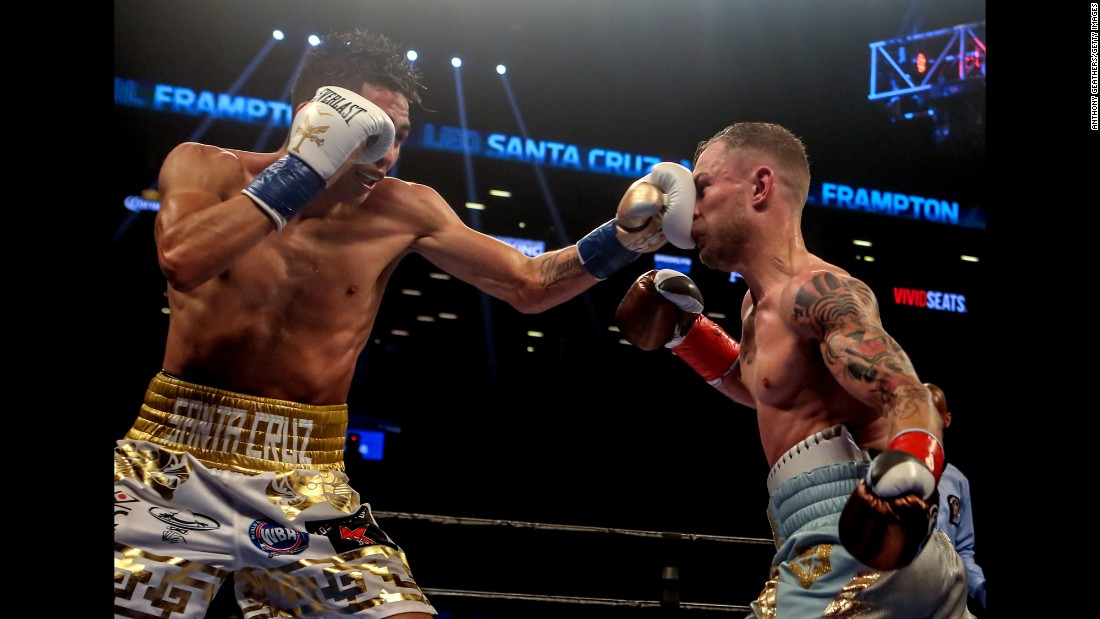 Leo Santa Cruz punches Carl Frampton during a title fight in Brooklyn, New York, on Saturday, July 30. Frampton won a majority decision to claim the WBA featherweight belt.