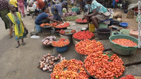 Vendors display tomatoes and pepper at Mile 12 market in Lagos.