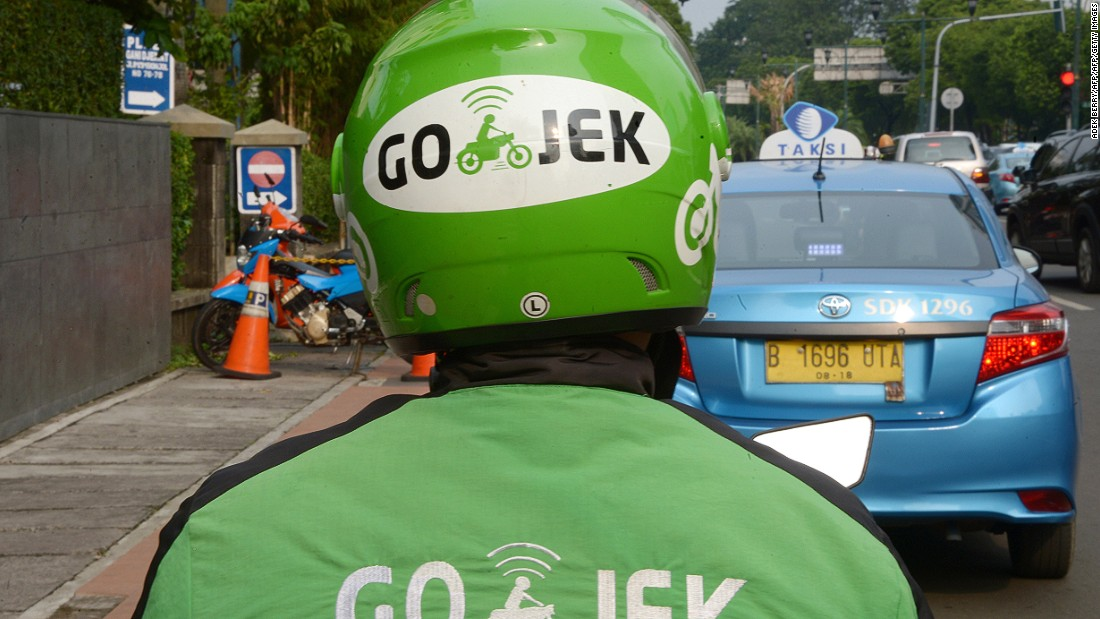 Go-Jek drivers are easy to spot in their bright green uniforms.